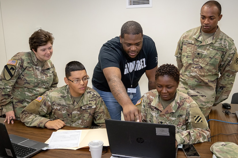 Gregory Martin, Defense Finance and Accounting Service Defense Military Pay Office lead military pay technician, trains U.S. Army Reserve and National Guard financial management Soldiers during Diamond Saber 2019 at Fort McCoy, Wis., June 28, 2019. DFAS brought realism to the Army's largest financial management exercise through live coding of actual Soldier's pay. (U.S. Army photo by Mark R. W. Orders-Woempner)