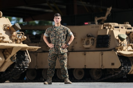 "U.S. Marine Cpl. Daniel Pedone, an M88A2 Hercules rigger with 2nd Tank Battalion, 2nd Marine Division, poses for a photo at Camp Lejeune, N.C., July 10, 2019. ""A good noncommissioned officer is like a good shield and is always the first line of defense for his or her Marines,"" Pedone said. He is from Summerfield, N.C. Pendone is a hard-working NCO who goes above and beyond what is asked. He constantly ensures his Marines know the daily objective and shows initiative in taking care of his Marines on a daily basis. He ensures the expectations of his Marines are met daily."