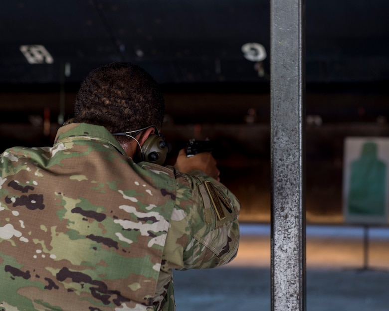 Staff Sgt. Rossitor Alexander, an instructor assigned to the 628th Security Forces Squadron Combat Arms Training and Maintenance flight, aims an M9 pistol at Joint Base Charleston, S.C. July 1, 2019. CATM facilitates readiness by equipping Airmen with the knowledge and skills to use weapons properly, and provides support to local and regional military branches. CATM instructors qualify for the weapons annually to maintain proficiency.