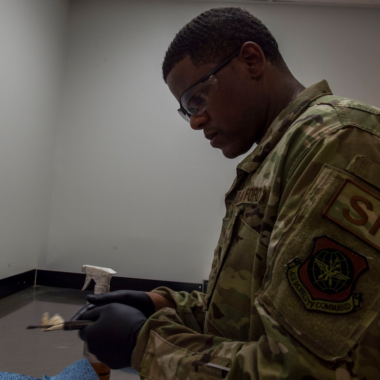 Staff Sgt. Rossitor Alexander, an instructor assigned to the 628th Security Forces Squadron Combat Arms Training and Maintenance flight, cleans an M9 pistol at Joint Base Charleston, S.C. July 1, 2019. CATM facilitates readiness by equipping Airmen with the knowledge and skills to use weapons properly, and provides support to local and regional military branches. CATM instructors qualify for the weapons annually to maintain proficiency.
