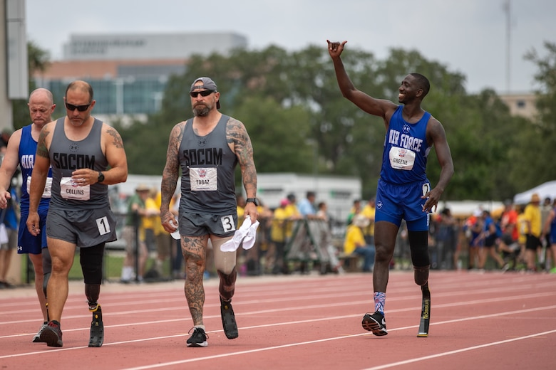 Air Force Reserve, Staff Sgt. Kevin Greene waves to his family in the stands as he walks to his starting position for the 800 meter race at the 2019 DoD Warrior Games.  Warrior Games is a Paralympic style sporting event with 300 athletes from all DoD service branches and five international coalition partners.  Active duty and veteran wounded warriors compete in 13 adaptive sports to inspire recovery, support rehabilitation and generate a wider understanding and respect of those who serve their country