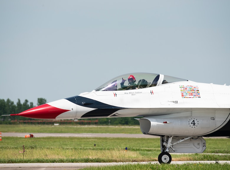 Maj. Whit Collins, Thunderbird No. 4, taxi's his F-16D during the Dayton-Vectren Airshow June 22, 2019. From their G-suits to the custom earpieces worn by the pilots to the F-16's transparent bubble canopy, the fly-by-wire flight controls and the pilot/vehicle interface, AFRL technologies accompany the Thunderbirds around the world as they perform in airshows.(U.S. Air Force photo/Rich Oriez)