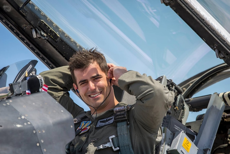 Maj. Whit Collins, Thunderbird No. 4, wears the Attenuating Custom Communications Earpiece System (ACCES®), a technology researched and developed by AFRL's Human Performance Wing in the 2000s. (Courtesy photo)
