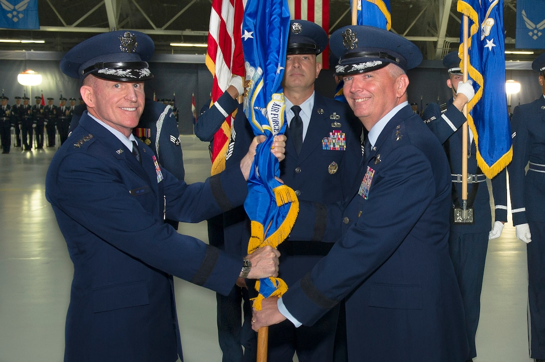 Maj. Gen. Ricky N. Rupp, right, assumes command of the Air Force District of Washington from Air Force Vice Chief of Staff Gen. Stephen Wilson during the AFDW Change of Command Ceremony at Joint Base Andrews, Md., July 9, 2019. Wilson presided over the ceremony where Maj. Gen. James A. Jacobson relinquished command. (U.S. Air Force photo by Master Sgt. Michael B. Keller)