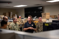 190711-N-OE749-0006 JOINT BASE LANGLEY-EUSTIS, Va. (July 11, 2019) Rick George, deputy director of communications at Joint Task Force Civil Support, gives a tour of the communication spaces and equipment at the command as part of the annual JTF-CS Defense Chemical, Biological, Radiological, Nuclear Response Force (DCRF) Communications Workshop. The two-day course is geared toward enhancing DCRF operations by providing vital training and face-to-face interaction between current and follow-on DCRF units. (U.S. Navy photo by Chief Mass Communication Specialist Barry A. Riley/RELEASED)