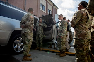 190711-N-OE749-0027 JOINT BASE LANGLEY-EUSTIS, Va. (July 11, 2019) Navy Information Systems Technician 1st Class Albert Givens, assigned to the communications department at Joint Task Force Civil Support, gives a tour of the command and control vehicle as part of the annual JTF-CS Defense Chemical, Biological, Radiological, Nuclear Response Force (DCRF) Communications Workshop. The two-day course is geared toward enhancing DCRF operations by providing vital training and face-to-face interaction between current and follow-on DCRF units. (U.S. Navy photo by Chief Mass Communication Specialist Barry A. Riley/RELEASED)