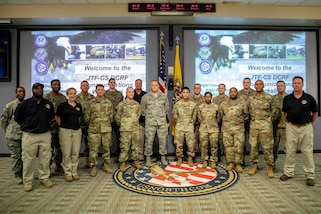 190711-N-OE749-0036 JOINT BASE LANGLEY-EUSTIS, Va. (July 11, 2019) Defense Chemical, Biological, Radiological, Nuclear Response Force (DCRF) Communications Workshop attendees pose for a photo at Joint Task Force Civil Support. The annual two-day course is geared toward enhancing DCRF operations by providing vital training and face-to-face interaction between current and follow-on DCRF units. (U.S. Navy photo by Chief Mass Communication Specialist Barry A. Riley/RELEASED)