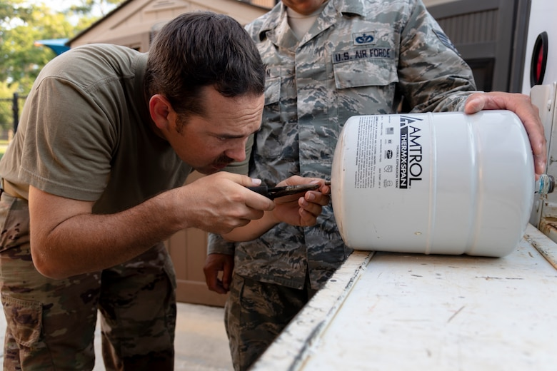 Staff Sgt. Daniel Champion, 23d Civil Engineer Squadron (CES) water and fuel systems maintenance craftsman, inspects an expansion tank, July 2, 2019, at Moody Air Force Base, Ga. Airmen from the 23d CES Water and Fuels Systems Maintenance are on-call 24/7 to sustain and maintain the base, water, sewer and gas lines and upkeep of the 696 facilities with water and fuel infrastructure. (U.S. Air Force photo by Airman 1st Class Taryn Butler)