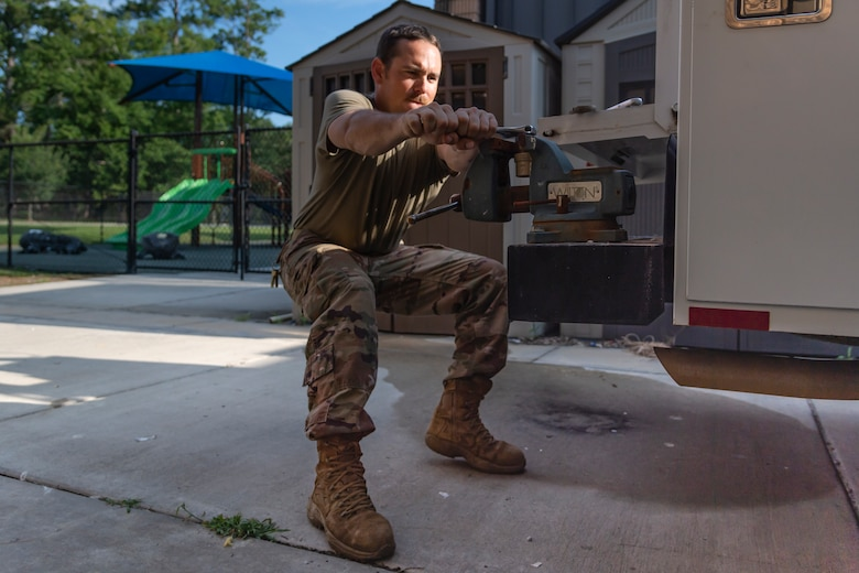 Staff Sgt. Daniel Champion, 23d Civil Engineer Squadron (CES) water and fuel systems maintenance craftsman, tightens a plug into a fitting, July 2, 2019, at Moody Air Force Base, Ga. Airmen from the 23d CES Water and Fuels Systems Maintenance are on-call 24/7 to sustain and maintain the base, water, sewer and gas lines and upkeep of the 696 facilities with water and fuel infrastructure. (U.S. Air Force photo by Airman 1st Class Taryn Butler)