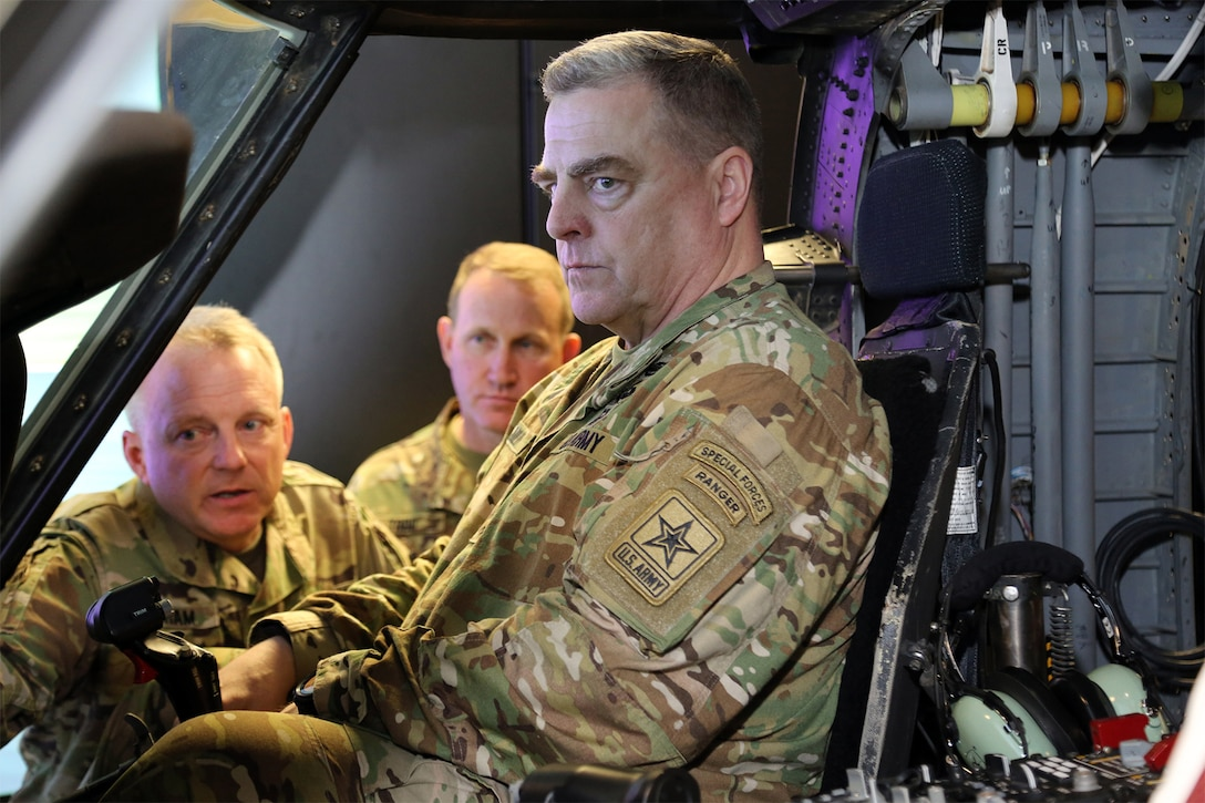 An Army officer sits in simulator.