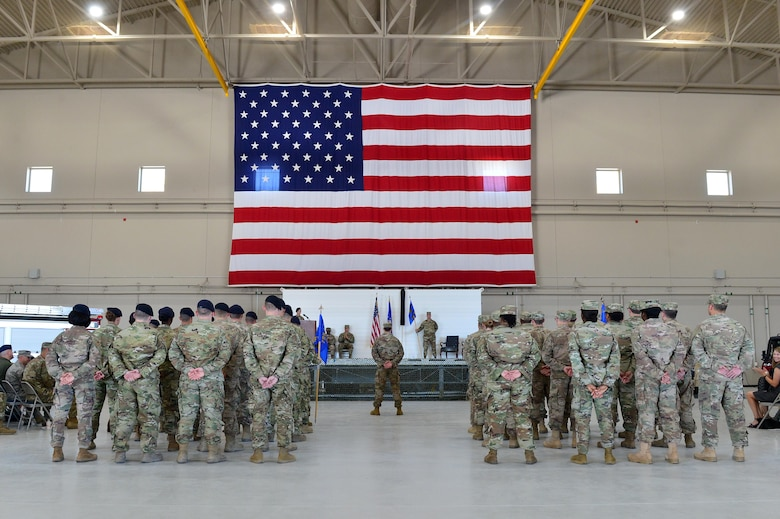 Airmen from the 799th Air Base Group stand in formation during the 432nd Mission Support Group activation ceremony at Creech Air Force Base, Nevada, July 11, 2019. During the ceremony, the 799th ABG was deactivated, and the Airmen who supported the unit were reassigned to the 432nd Mission Support Group as it activated immediately following. (U.S. Air Force photo by Senior Airman Haley Stevens)