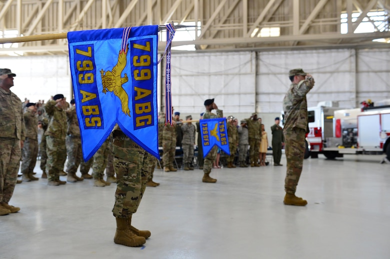 The 799th Air Base Squadron flag is presented for The National Anthem, during the 432nd Mission Support Group activation ceremony at Creech Air Force Base, Nevada, July 11, 2019. Standing up a mission support group for the 432nd Wing was among the first steps to prepare the wing to take installation command. (U.S. Air Force photo by Senior Airman Haley Stevens)