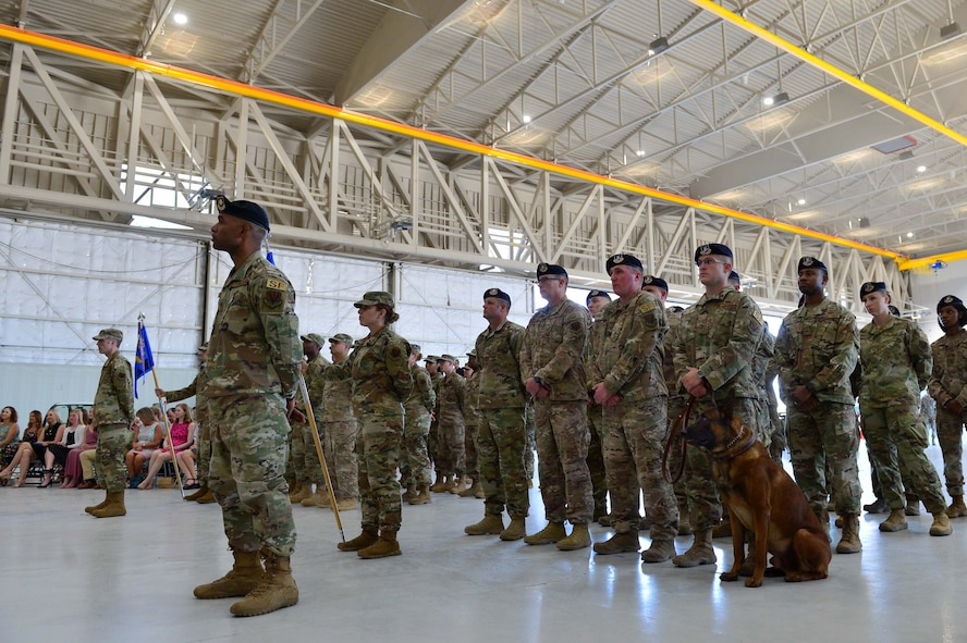 Members of the 432nd Mission Support Group listen to Col. Brian, 432nd MSG commander, as he gives opening comments to his new Airmen during the 432nd MSG activation ceremony at Creech Air Force Base, Nevada, July 11, 2019. The 799th Air Base Group began supporting Creech Airmen in 2012, but now the 432nd MSG will be taking over some of those support functions. (U.S. Air Force photo by Senior Airman Haley Stevens)