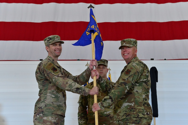 Col. Brian, 432nd Mission Support Group commander, assumes command of the newly activated 432nd MSG from Col. Stephen Jones, 432nd Wing/432nd Air Expeditionary Wing commander, at Creech Air Force Base, Nevada, July 11, 2019. The newly activated 432nd MSG will provide support functions such as personnel, civil engineering and services support to improve the quality of life on Creech while allowing the base to become more self-reliant. (U.S. Air Force photo by Senior Airman Haley Stevens)