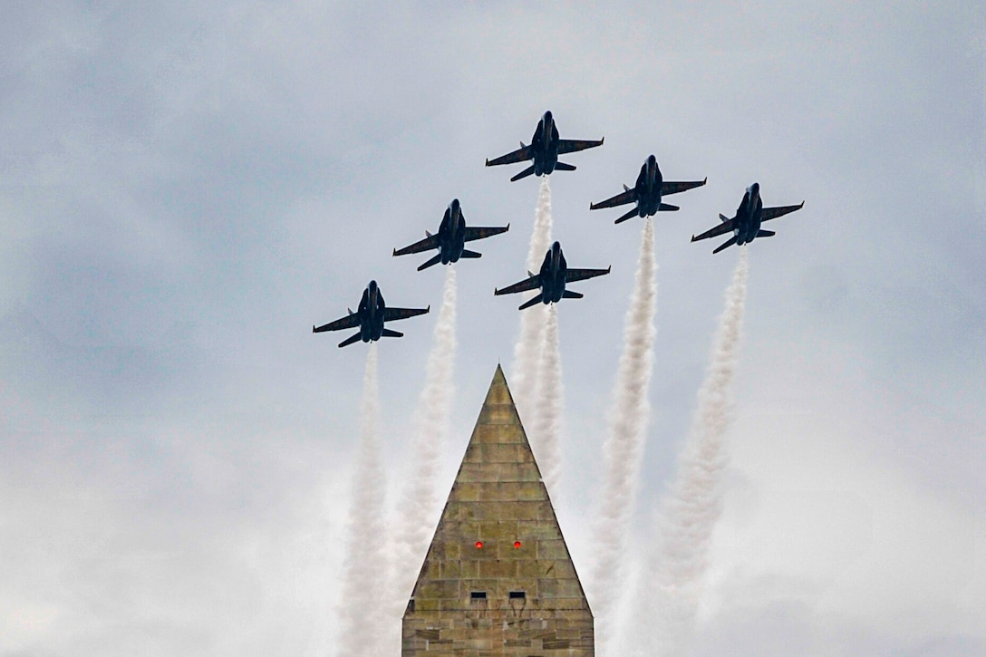 Six jets fly over the Washington Monument.