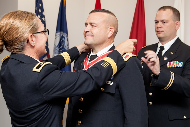 Col. David Ray, U.S. Army Corps of Engineers Sacramento District commander, is awarded the Silver Order of the de Fleury Medal from Brig. Gen. Kim Colloton, South Pacific Division commander, prior to Ray relinquishing command and retiring on July 11, 2019, in downtown Sacramento, Calif.
