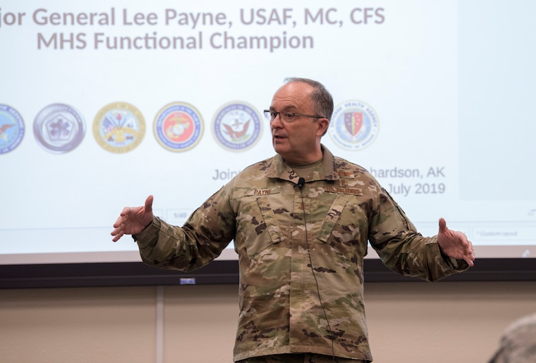 U.S. Air Force Maj. Gen. Lee E. Payne, Defense Health Agency Assistant Director for Combat Support, and Military Health System Electronic Health Record Functional Champion, briefs Joint Base Elmendorf-Richardson's medical personnel during his visit at JBER, Alaska, July 9, 2019. Payne discussed upcoming changes to MHS and what that means for patients and providers.