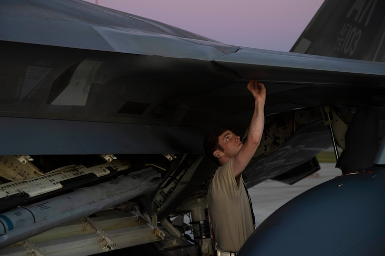 An Airman assigned to Joint Base Elmendorf-Richardson, Alaska, performs regular maintenance on U.S. Air Force F-22 Raptors after they arrive July 9, to Royal Australian Air Force Base Amberley, Australia, in support of Talisman Sabre 19. Talisman Sabre is a bilateral combined Australian and United States training activity designed to improve interoperability increase combat readiness. (U.S. Air Force photo by Senior Airman Elora J. Martinez)
