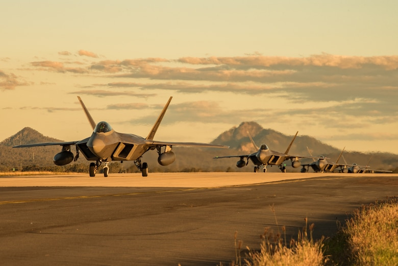 F-22 Raptors assigned to the 90th Fighter Squadron, Joint Base Elmendorf-Richardson, Alaska, taxi to their parking location at the Royal Australian Air Force Base Amberley flightline for Talisman Sabre 19, July 9. Talisman Sabre provides effective and intense training to ensure U.S. Forces are combat ready, capable, interoperable, and deployable on short notice. (U.S. Air Force photo by Staff Sgt. Kyle Johnson)