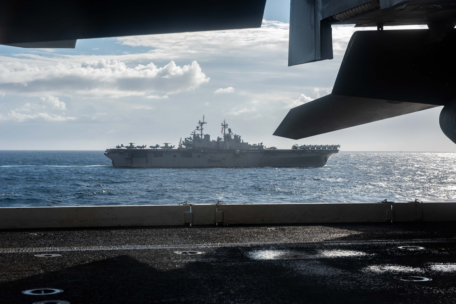 CORAL SEA (July 11, 2019) Amphibious assault ship USS Wasp (LHD 1) sails alongside the forward deployed aircraft carrier USS Ronald Reagan (CVN 76), as U.S. Navy, U.S. Coast Guard, Royal Australian Navy, Royal Canadian Navy and Japan Maritime Self-Defense Force ships sail together in formation during Talisman Sabre 2019. Talisman Sabre 2019 illustrates the closeness of the Australian and U.S. alliance and the strength of the military-to-military relationship. This is the eighth iteration of this exercise.