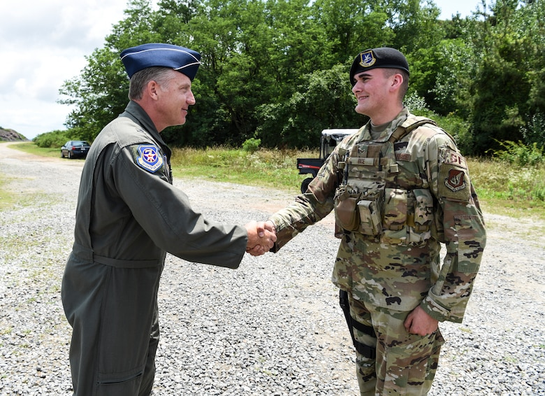U.S. Air Force Brig. Gen. David Eaglin (left), 7th Air Force vice commander, shakes hands with Airman 1st Class Matthew Bice, 8th Security Forces Squadron member, during an immersion tour at Kunsan Air Base, Republic of Korea, July 12, 2019. Eaglin saw how the 8th SFS is ready to fulfill their critical role of defending the base. (U.S. Air Force photo by Staff Sgt. Joshua Edwards)