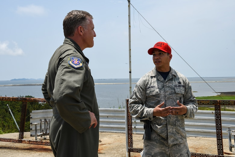 U.S. Air Force Brig. Gen. David Eaglin (left), 7th Air Force vice commander, is briefed by Tech. Sgt. Ryan Salinas, 8th Security Forces Squadron combat arms non-commissioned officer in charge, during an immersion tour at Kunsan Air Base, Republic of Korea, July 12, 2019. Eaglin had the opportunity to sample some of the weaponry the 8th SFS uses to defend the base. (U.S. Air Force photo by Staff Sgt. Joshua Edwards)