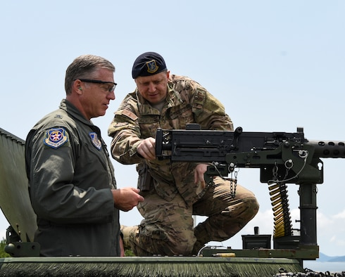 U.S. Air Force Brig. Gen. David Eaglin (left), 7th Air Force vice commander, receives instructions from Staff Sgt. Jared Hepworth, 8th Security Forces Squadron member, during an immersion tour at Kunsan Air Base, Republic of Korea, July 12, 2019. Eaglin had the opportunity to sample some of the weaponry the 8th SFS uses to defend the base. (U.S. Air Force photo by Staff Sgt. Joshua Edwards)