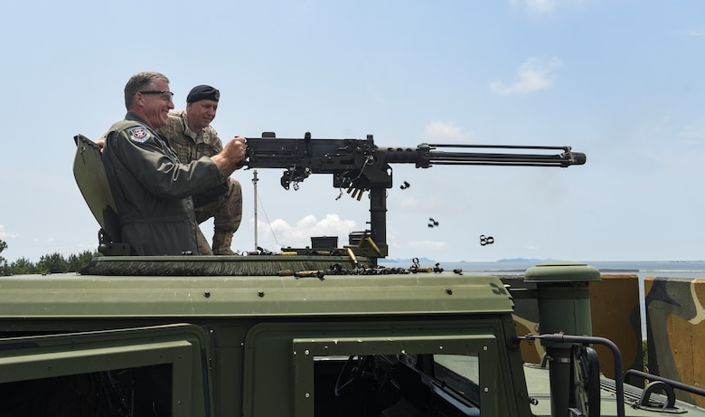 U.S. Air Force Brig. Gen. David Eaglin, 7th Air Force vice commander, fires an M2 heavy machine gun during an immersion tour at Kunsan Air Base, Republic of Korea, July 12, 2019. Eaglin had the opportunity to sample some of the weaponry the 8th SFS uses to defend the base. (U.S. Air Force photo by Staff Sgt. Joshua Edwards)