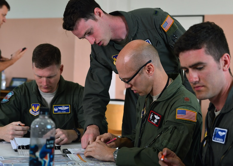 Pilots assigned to the 37th Airlift Squadron accomplish a preflight mission brief at Powidz Air Base, Poland, July 10, 2019. Members from the 86th Airlift Wing and the 37th AS exercise with the Polish air force on a quarterly basis to maintain joint readiness. (U.S. Air Force photo by Staff Sgt. Jimmie D. Pike)