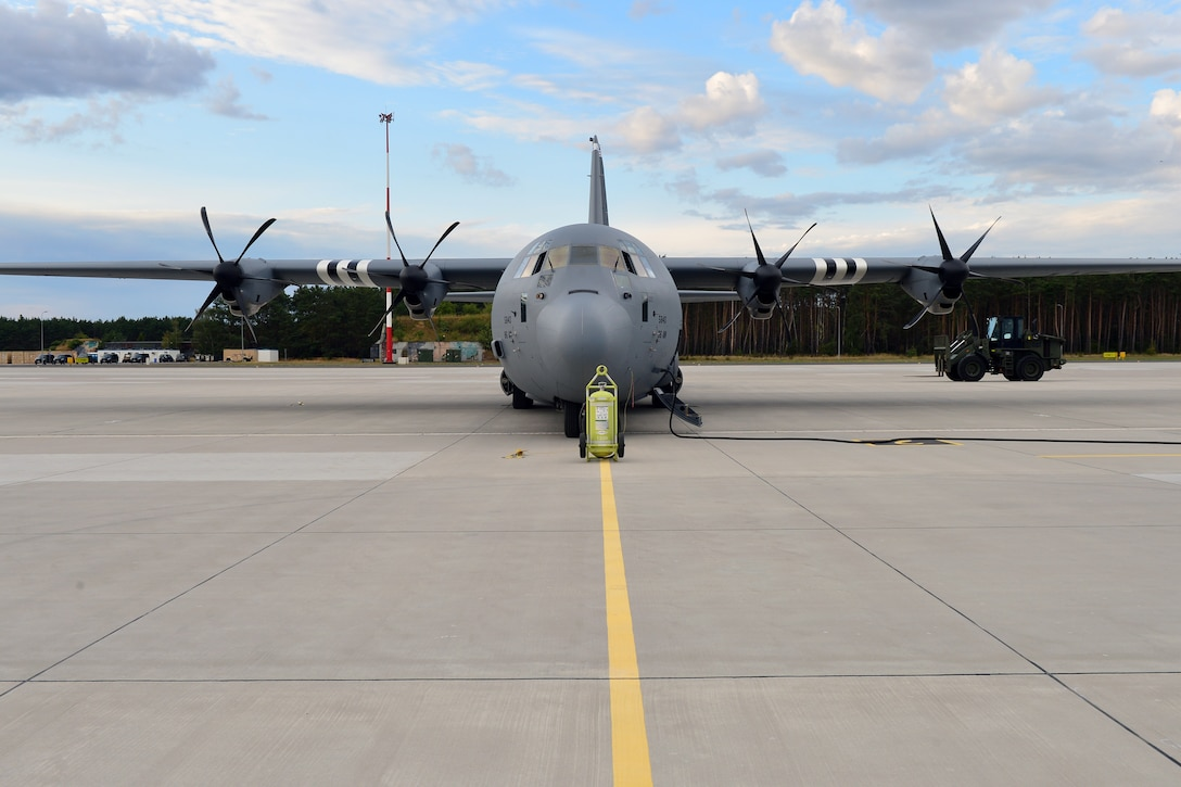 A C-130J Super Hercules assigned to the 37th Airlift Squadron sits on the flightline before takeoff at Powidz Air Base, Poland, July 10, 2019. Aviation Rotation is a continuing bilateral training exercise between the U.S. and Polish air forces to increase partnership capacities. (U.S. Air Force photo by Staff Sgt. Jimmie D. Pike)