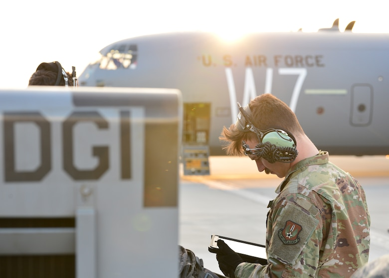 U.S. Air Force Staff Sgt. Joshua Poindexter, 86th Aircraft Maintenance Squadron flying crew chief, runs through a preflight checklist for a C-130J Super Hercules at Powidz Air Base, Poland, July 10, 2019. Approximately 80 Airmen and three aircraft deployed to Powidz Air Base in support of Aviation Rotation 19-3, a bilateral training exercise between the U.S. and Polish air forces. (U.S. Air Force photo by Staff Sgt. Jimmie D. Pike)