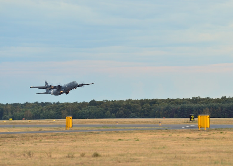 A C-130J Super Hercules assigned to the 37th Airlift Squadron takes off from Powidz Air Base, Poland, July 10, 2019. Aviation Rotation is a continuing bilateral training exercise between the U.S. and Polish air forces to increase partnership capacities. (U.S. Air Force photo by Staff Sgt. Jimmie D. Pike)