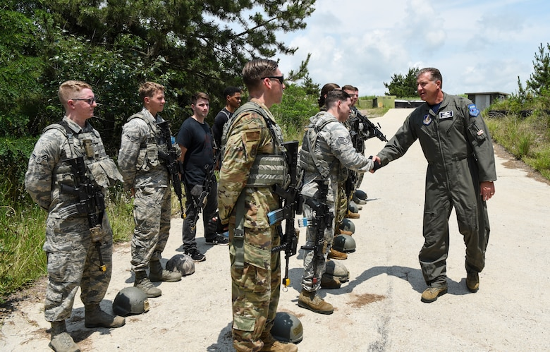 U.S. Air Force Brig. Gen. David Eaglin (right), 7th Air Force vice commander, shakes hands with members from the 8th Security Forces Squadron during an immersion tour at Kunsan Air Base, Republic of Korea, July 12, 2019. Eaglin introduced himself and recognized some of the Airmen from the Wolf Pack for their professionalism and readiness. (U.S. Air Force photo by Staff Sgt. Joshua Edwards)