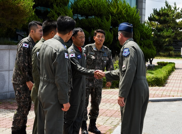 U.S. Air Force Brig. Gen. David Eaglin (right), 7th Air Force vice commander, shakes hands with 38th Fighter Group leadership July 12, 2019, at Kunsan Air Base, Republic of Korea. Eaglin visited Kunsan, to get a chance to see first-hand the capabilities the Wolf Pack and Republic of Korea Air Force bring to the table. (U.S. Air Force photo by Staff Sgt. Joshua Edwards)