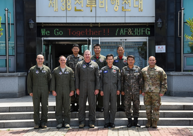 U.S. Air Force Brig. Gen. David Eaglin (third from the left), 7th Air Force vice commander, poses for a photo with 8th Fighter Wing and 38th Fighter Group leadership at Kunsan Air Base, Republic of Korea, July 12, 2019. Eaglin went on an immersion tour at Kunsan, to see first-hand the capabilities the Wolf Pack and Republic of Korea Air Force bring to the table. (U.S. Air Force photo by Staff Sgt. Joshua Edwards)