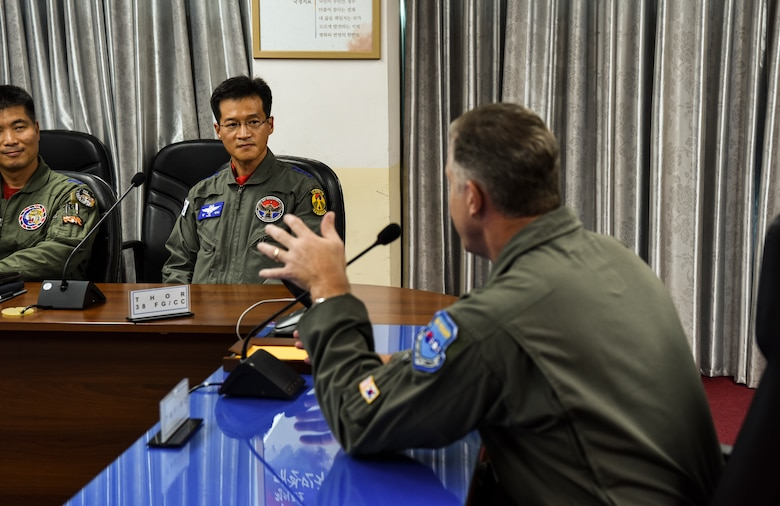 U.S. Air Force Brig. Gen. David Eaglin (right), 7th Air Force vice commander, speaks with Col. Keun-Shin Kang, 38th Fighter Group commander, during an immersion tour at Kunsan Air Base, Republic of Korea, July 12, 2019. Eaglin visited Kunsan and Republic of Korea Air Force's 38th FG to introduce himself and strengthen the partnership between the U.S. and ROK. (U.S. Air Force photo by Staff Sgt. Joshua Edwards)