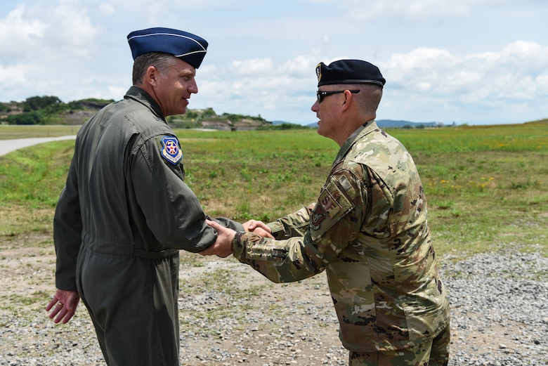 U.S. Air Force Brig. Gen. David Eaglin (left), 7th Air Force vice commander, shakes hands with Lt. Col. Eric Horst, 8th Security Forces Squadron commander, during an immersion tour at Kunsan Air Base, Republic of Korea, July 12, 2019. Eaglin saw how the 8th SFS is ready to fulfill their critical role of defending the base. (U.S. Air Force photo by Staff Sgt. Joshua Edwards)