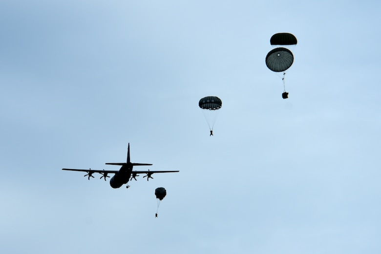 U.S. Airmen assigned to the 57th Rescue Squadron jump from a C-130J Hercules assigned to Ramstein Air Base, Germany, during over-water parachute training off the coast of Italy, July 9, 2019. Airmen assigned to the 57th RQS participated in jump training over the course of the week, both on land and over water. (U.S. Air Force photo by Staff Sgt. Kelsey Tucker)