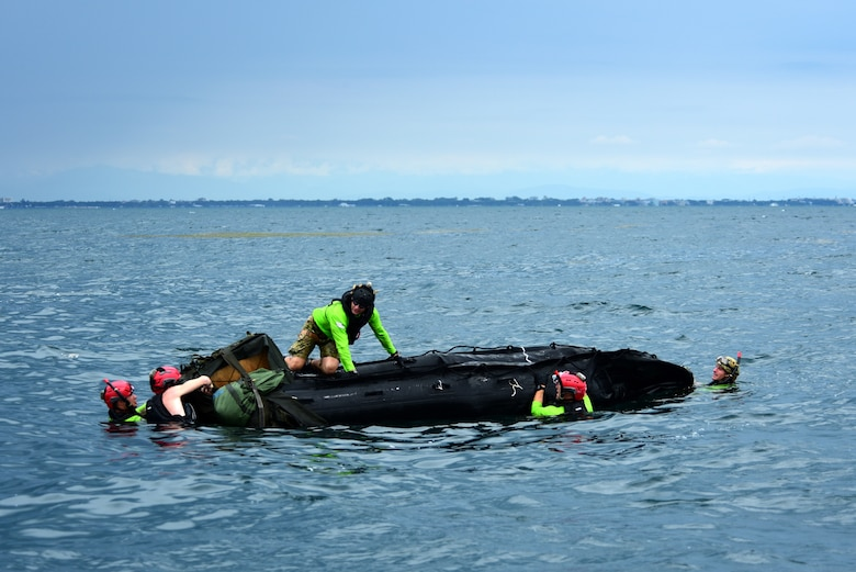 U.S. Air Force pararescuemen assigned to the 57th Rescue Squadron prepare a rigged alternate method zodiac (RAMZ) during over-water parachute training off the coast of Italy, July 9, 2019. The RAMZ is an inflatable, motorized boat that is airdropped alongside jumpers into the water. (U.S. Air Force photo by Staff Sgt. Kelsey Tucker)