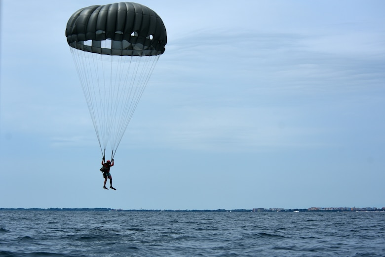 A U.S. Air Force pararescueman assigned to the 57th Rescue Squadron parachutes into the ocean during over-water parachute training off the coast of Italy, July 9, 2019. The Airmen partnered with C-130J Hercules aircraft and crews from Ramstein Air Base, Germany, in order to complete their quarterly parachute training. (U.S. Air Force photo by Staff Sgt. Kelsey Tucker)