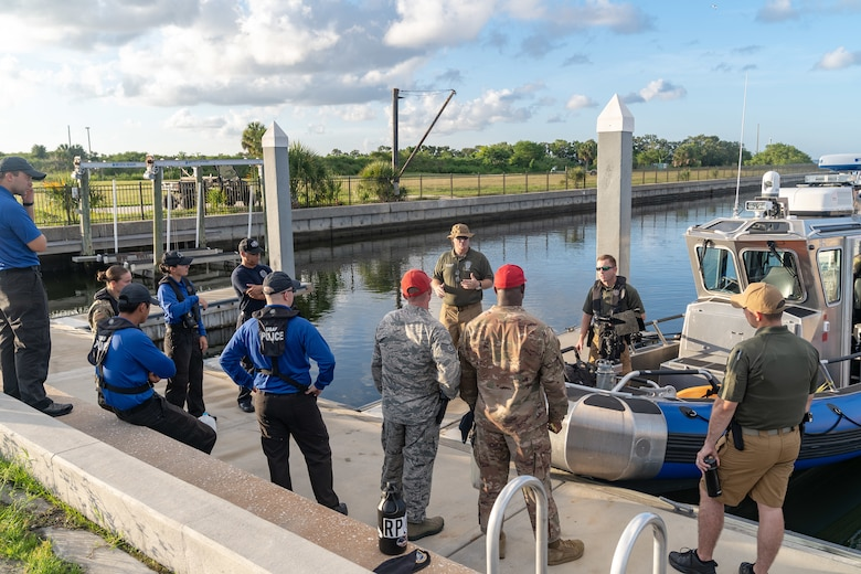 Department of the Air Force Police Lt. Todd C. Barrett, Officer in Charge of marine patrol, conducts a safety briefing for Airmen before they depart the marina on MacDill Air Force Base, Fla., July 2, 2019.