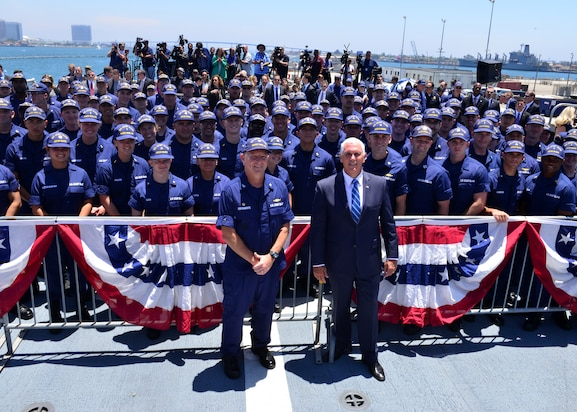 Vice President Mike Pence stands with U.S. Coast Guard members.