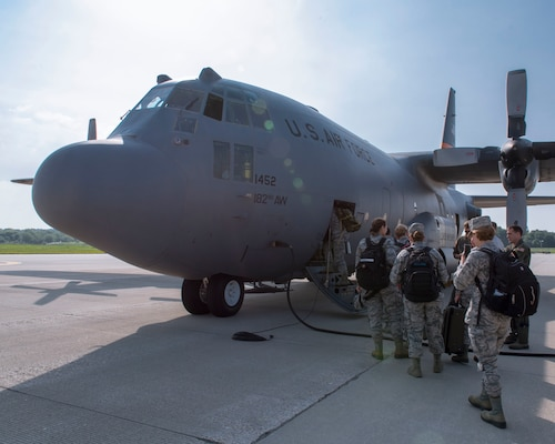 Airmen assigned to the 115th Fighter Wing, Madison, Wisconsin, board an Illinois Air National Guard C-130 Hercules for transport to New York July 9, 2019, for the Greater Chenango Cares and Healthy Cortland Innovative Readiness Training.