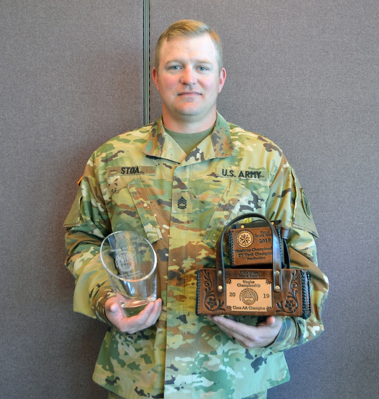 Sgt. 1st Class Brian Stoa, USAR Operations NCOIC for the Oklahoma City Recruiting Battalion and a champion shotgun shooter, poses with three of the trophies he's already won in past three months.