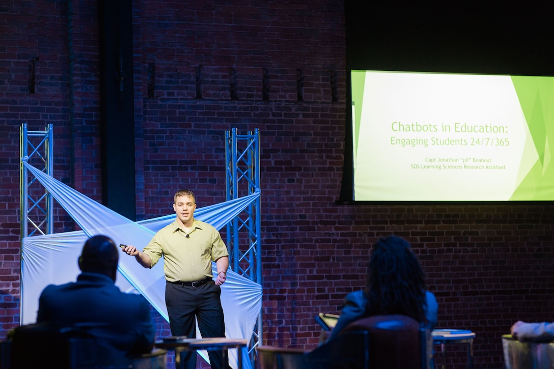 Captain Jonathan Beabout, a former Squadron Officer School student research assistant, pitches his idea for leveraging chatbot technology across Air Education and Training Command educational platforms at the MGMWERX Pitch Night, May 21, 2019, Montgomery, Alabama. The captain, the chief of weapons and tactics at Lackland AFB, Texas, developed his idea while taking SOS's Air University Advanced Research Elective.