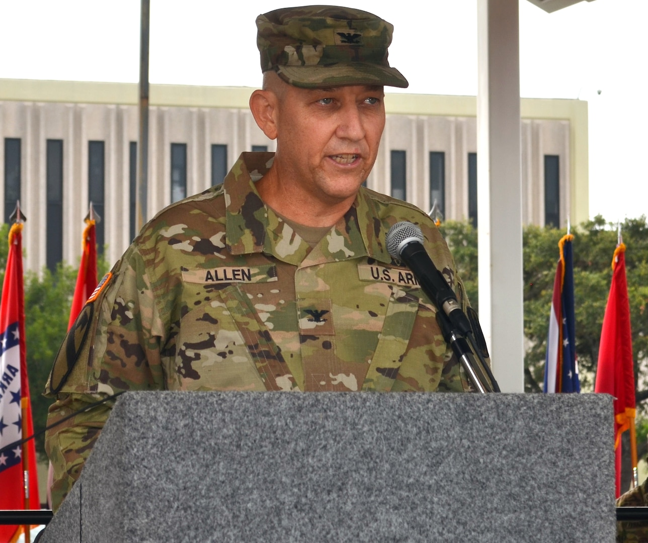 Col. Daniel Allen gives his first remarks as commander of the 470th Military Intelligence Brigade during the brigade's change of command ceremony at the MacArthur Parade Field at Joint Base San Antonio-Fort Sam Houston July 9.