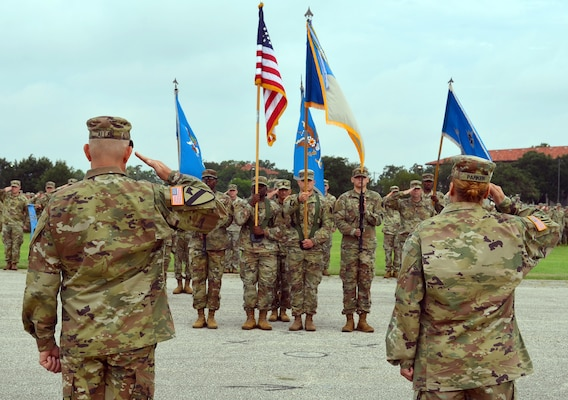 Col. Daniel Allen (left), 470th Military Intelligence Brigade incoming commander, and Col. Ingrid Parker (right), 470th MI Brigade outgoing commander, salute the colors during the brigade's change of command ceremony at the MacArthur Parade Field at Joint Base San Antonio-Fort Sam Houston July 9.