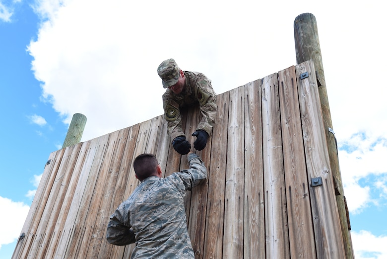 scaling a wall