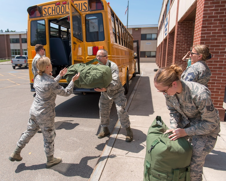 Airmen assigned to the 115th Fighter Wing, Madison, Wisconsin, arrive at Cortland High School New York July 9, 2019, for the Greater Chenango Cares and Healthy Cortland Innovative Readiness Training. The IRT mission is comprised of Active Duty Air Force, Army, Navy, Reserves and National Guard troops working alongside our local community partners to bring health care and veterinary services to the underserved communities of Cortland and Chenango counties. (U.S. Air National Guard photo by Airman 1st Class Cameron Lewis)