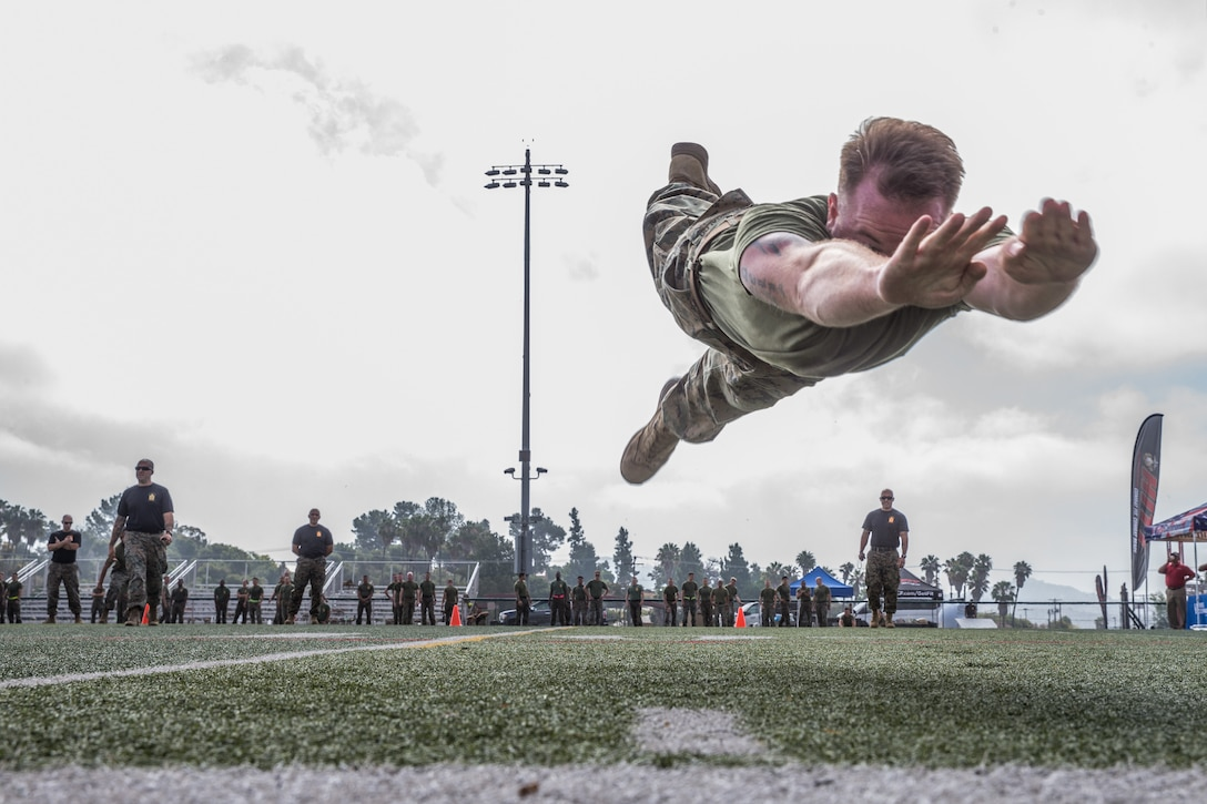 A Marine jumps through the air during a sporting event.